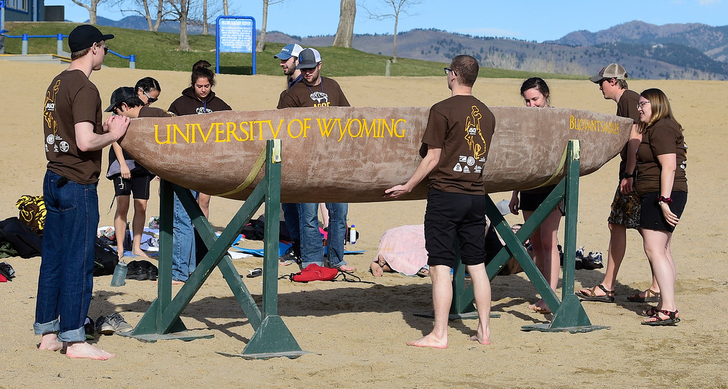 . BOULDER, CO - April 6, 2019:  The University of Wyoming team goes over last minute details before the start of the races. CU Boulder�s student chapter of the American Society of Civil Engineers hosted the 2019 Rocky Mountain Student Conference. The concrete canoe races, at the Boulder Reservoir, are one of the highlights. The annual event provides civil engineering students with an opportunity to gain hands-on practical experience and leadership skills by using concrete to design, build and test viable watercraft. (Photo by Cliff Grassmick/Staff Photographer)