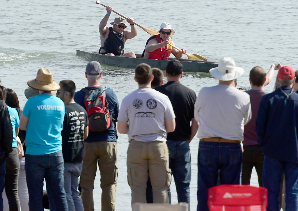 . BOULDER, CO - April 6, 2019:  A two person crew races to the finish line. CU Boulder�s student chapter of the American Society of Civil Engineers hosted the 2019 Rocky Mountain Student Conference. The concrete canoe races, at the Boulder Reservoir, are one of the highlights. The annual event provides civil engineering students with an opportunity to gain hands-on practical experience and leadership skills by using concrete to design, build and test viable watercraft. (Photo by Cliff Grassmick/Staff Photographer)