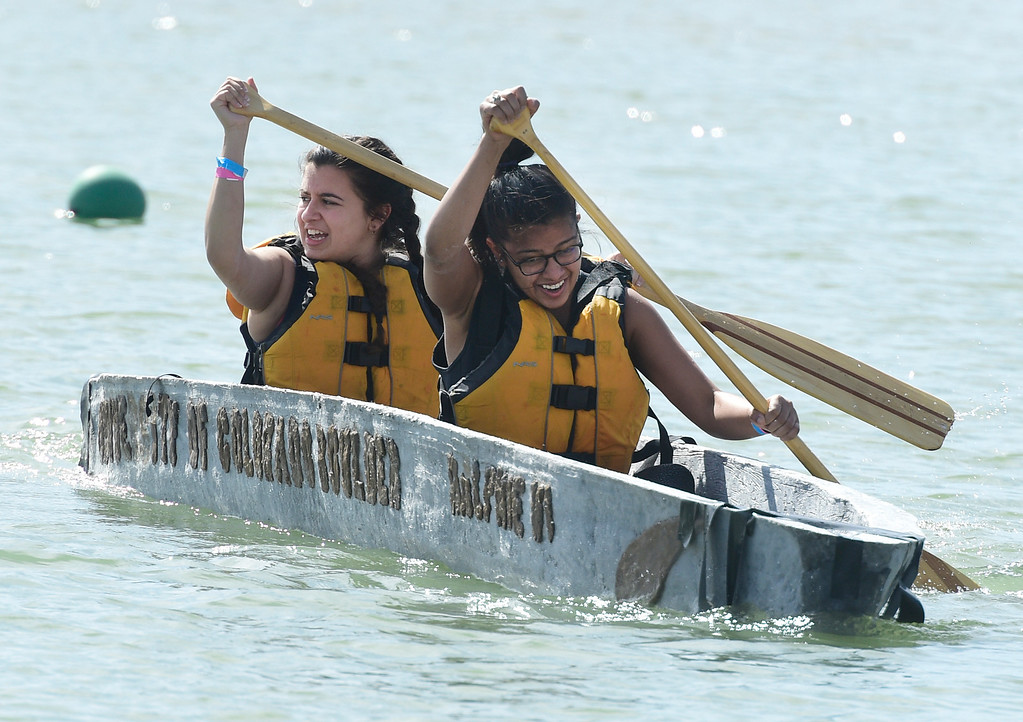 . BOULDER, CO - April 6, 2019:  Mia Abouhamad, left, and Richa Manjari, of the CU team, sprint out from the start line. CU Boulder�s student chapter of the American Society of Civil Engineers hosted the 2019 Rocky Mountain Student Conference. The concrete canoe races, at the Boulder Reservoir, are one of the highlights. The annual event provides civil engineering students with an opportunity to gain hands-on practical experience and leadership skills by using concrete to design, build and test viable watercraft. (Photo by Cliff Grassmick/Staff Photographer)