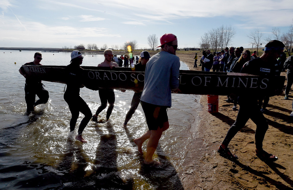 . BOULDER, CO - April 6, 2019:  The Colorado School of Mines team remove their craft after swamping. CU Boulder�s student chapter of the American Society of Civil Engineers hosted the 2019 Rocky Mountain Student Conference. The concrete canoe races, at the Boulder Reservoir, are one of the highlights. The annual event provides civil engineering students with an opportunity to gain hands-on practical experience and leadership skills by using concrete to design, build and test viable watercraft. (Photo by Cliff Grassmick/Staff Photographer)