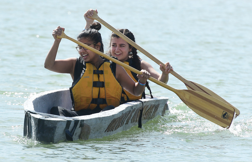 . BOULDER, CO - April 6, 2019: Richa Manjari, left, and  Mia Abouhamad, of the CU team, sprint out from the start line. CU Boulder�s student chapter of the American Society of Civil Engineers hosted the 2019 Rocky Mountain Student Conference. The concrete canoe races, at the Boulder Reservoir, are one of the highlights. The annual event provides civil engineering students with an opportunity to gain hands-on practical experience and leadership skills by using concrete to design, build and test viable watercraft. (Photo by Cliff Grassmick/Staff Photographer)