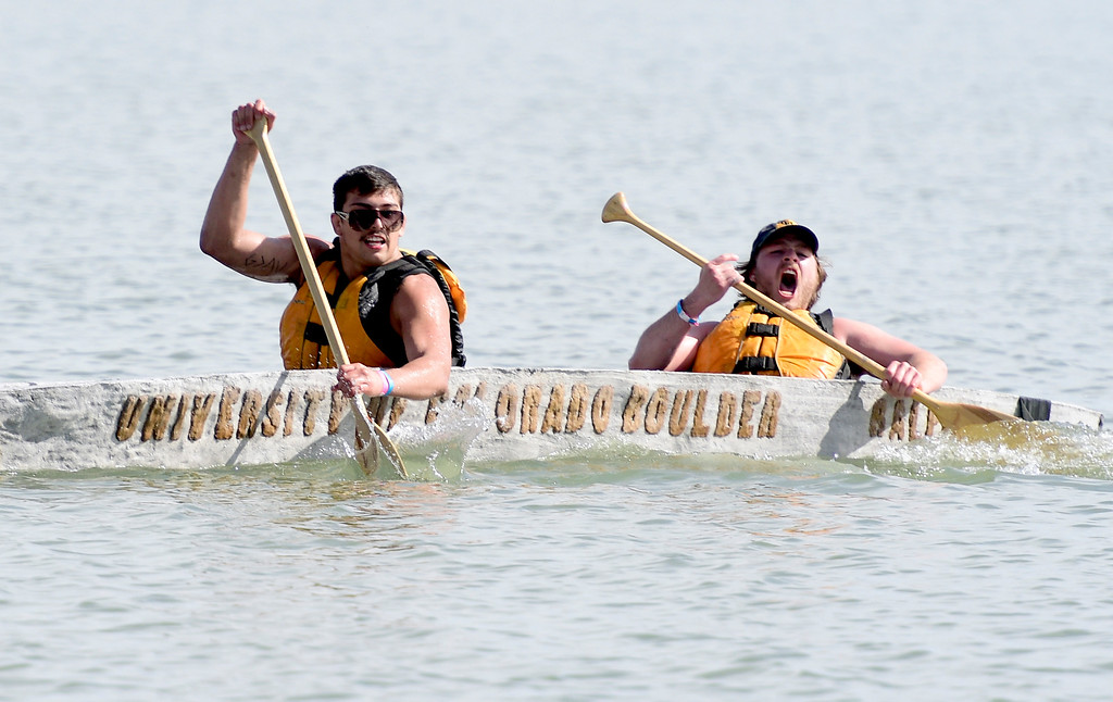 . BOULDER, CO - April 6, 2019:  Alec Guevara, left, and Mason Bell, of CU, push it to the finish. CU Boulder�s student chapter of the American Society of Civil Engineers hosted the 2019 Rocky Mountain Student Conference. The concrete canoe races, at the Boulder Reservoir, are one of the highlights. The annual event provides civil engineering students with an opportunity to gain hands-on practical experience and leadership skills by using concrete to design, build and test viable watercraft. (Photo by Cliff Grassmick/Staff Photographer)