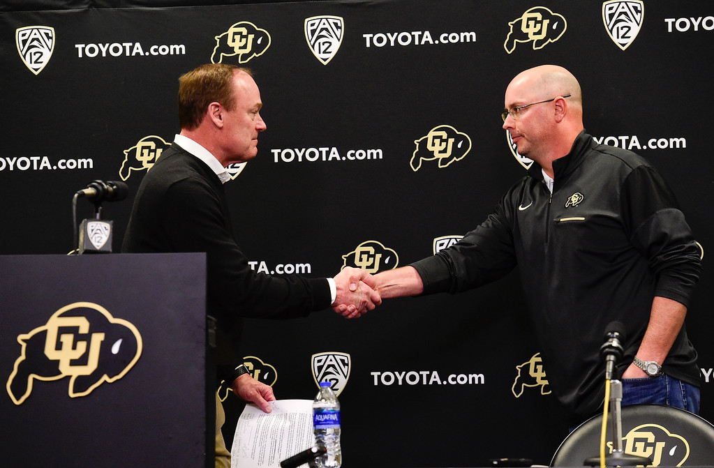 . BOULDER, CO - NOVEMBER 18:University of Colorado  athletic director Rick George shakes hands with interim head football coach Kurt Roper during a press conference at the Champions Center in Boulder on Nov. 17, 2018. Head coach Mike MacIntyre was dismissed on Sunday.  (Photo by Matthew Jonas/Staff Photographer)