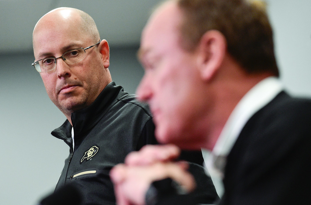 . BOULDER, CO - NOVEMBER 18:University of Colorado interim head football coach Kurt Roper listens as athletic director Rick George speaks during a press conference at the Champions Center in Boulder on Nov. 17, 2018. Head coach Mike MacIntyre was dismissed on Sunday.  (Photo by Matthew Jonas/Staff Photographer)