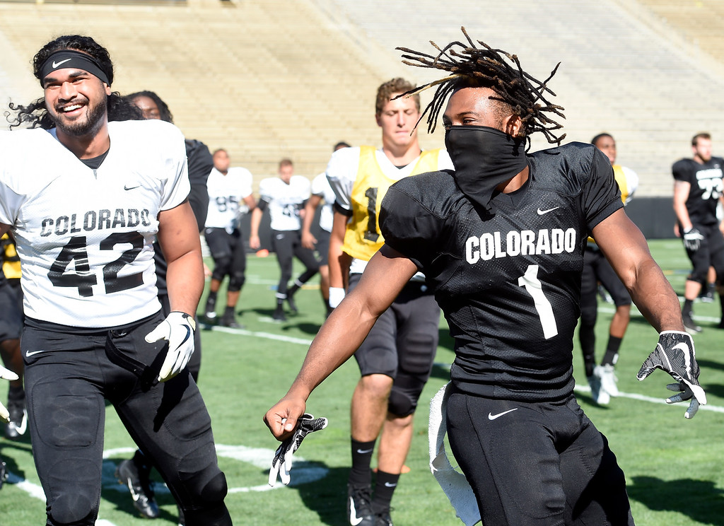 . Boulder, CO - AUGUST 11: Nu\'umotu Falo, left, and Donovan Lee, during the University of Colorado football scrimmage on August 11, 2018.(Photo by Cliff Grassmick/Staff Photographer)