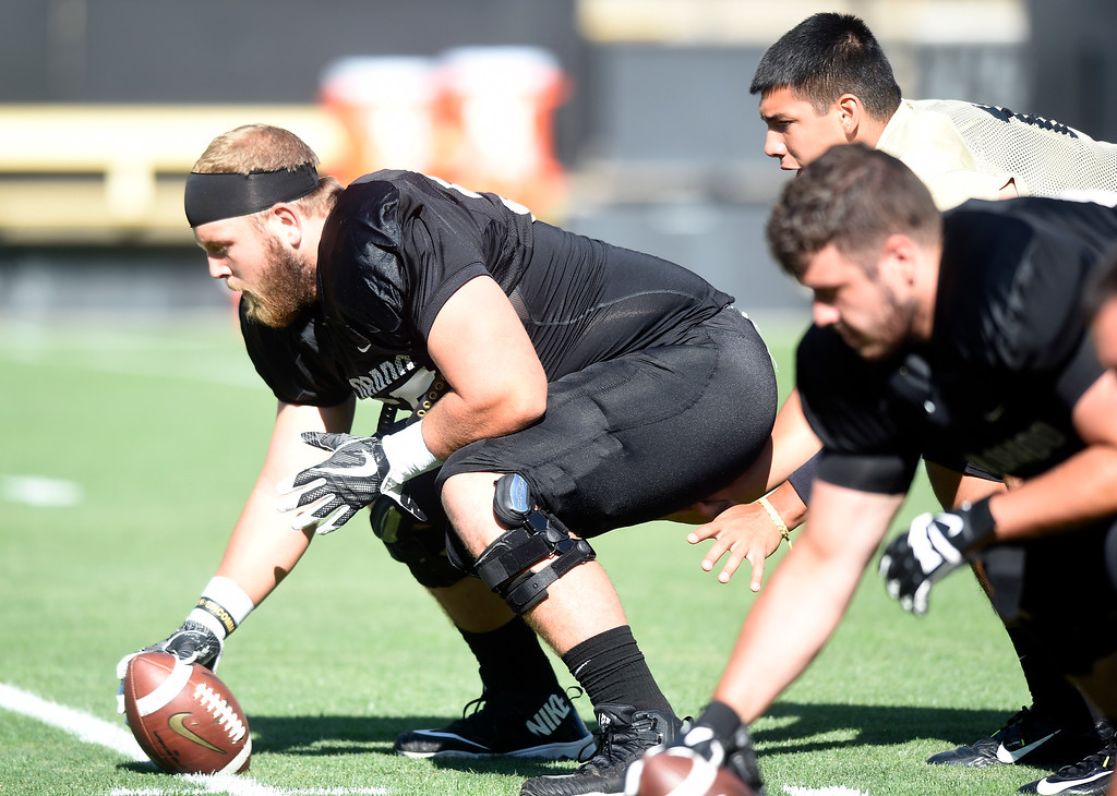 . Boulder, CO - AUGUST 11: Brett Tonz at center during the University of Colorado football scrimmage on August 11, 2018.(Photo by Cliff Grassmick/Staff Photographer)