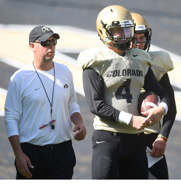 . Boulder, CO - AUGUST 11: Kurt Roper, left, with Sam Noyer, during the University of Colorado football scrimmage on August 11, 2018.(Photo by Cliff Grassmick/Staff Photographer)