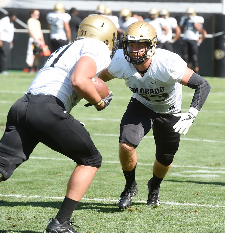 . Boulder, CO - AUGUST 11: Nate Landman, right, during the University of Colorado football scrimmage on August 11, 2018.(Photo by Cliff Grassmick/Staff Photographer)