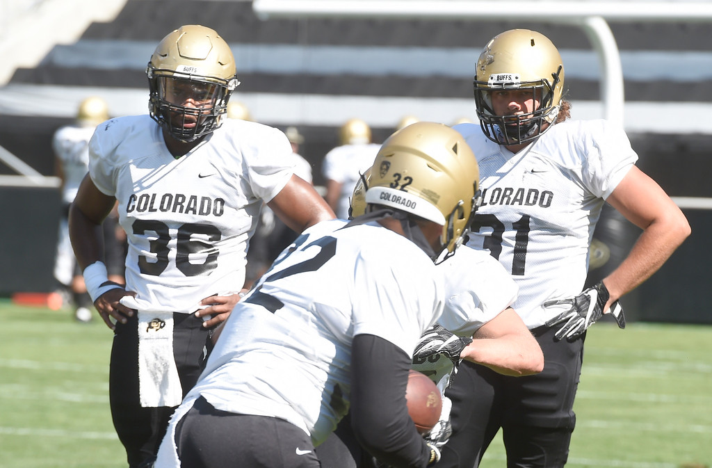. Boulder, CO - AUGUST 11: Akil Jones, left, and Jonathan Van Diest, during the University of Colorado football scrimmage on August 11, 2018.(Photo by Cliff Grassmick/Staff Photographer)