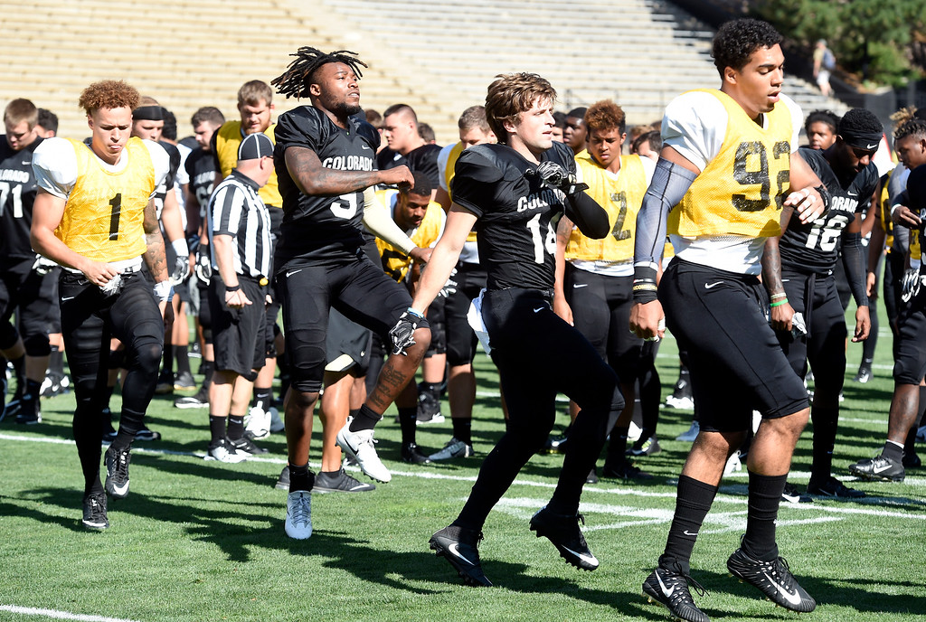 . Boulder, CO - AUGUST 11: Dante Wigley, left, Juwann Winfree, Jay MacIntyre, and Drew Lewis,  during the University of Colorado football scrimmage on August 11, 2018.(Photo by Cliff Grassmick/Staff Photographer)