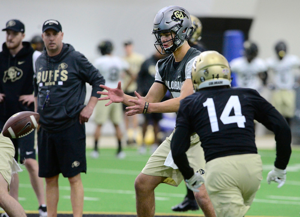 . University of Colorado\'s quarterback Tyler Lytle readies to hand off to Jay MacIntyre during practice on the CU Boulder Campus on Friday. For more photos go to buffzone.com Paul Aiken Staff Photographer Feb 23 2018