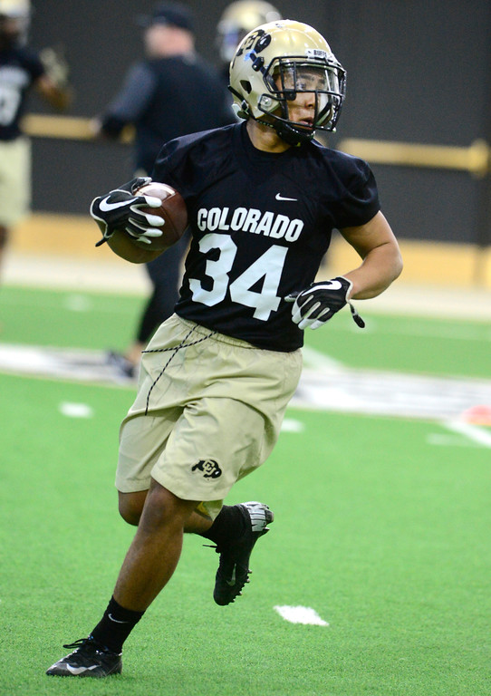 . University of Colorado\'s tailback Noa Lukela runs with the ball during practice on the CU Boulder Campus on Friday. For more photos go to buffzone.com Paul Aiken Staff Photographer Feb 23 2018