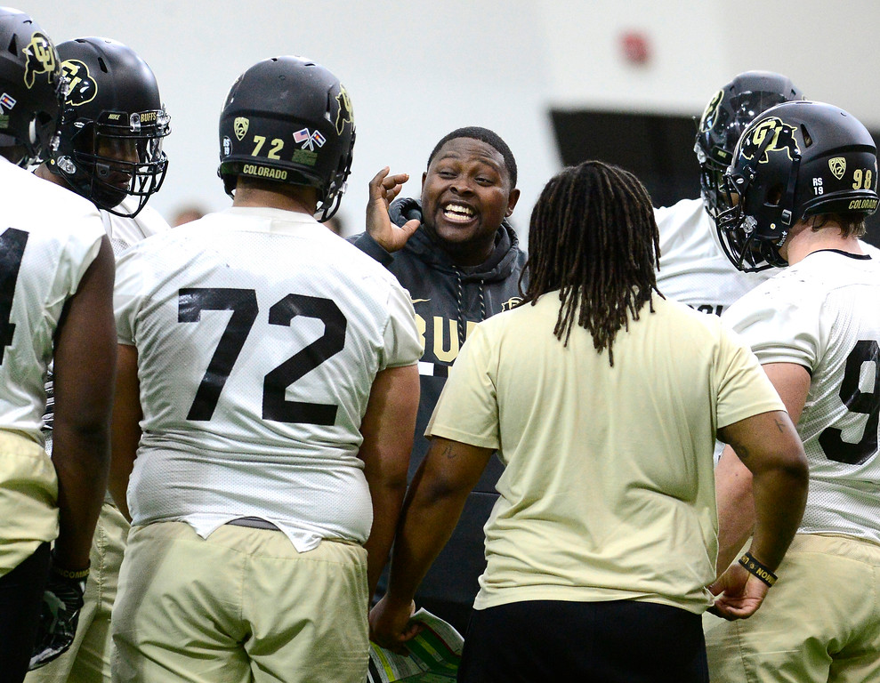 . University of Colorado\'s assistant coach Kwahn Drake talks to the defensive line during practice on the CU Boulder Campus on Friday. For more photos go to buffzone.com Paul Aiken Staff Photographer Feb 23 2018