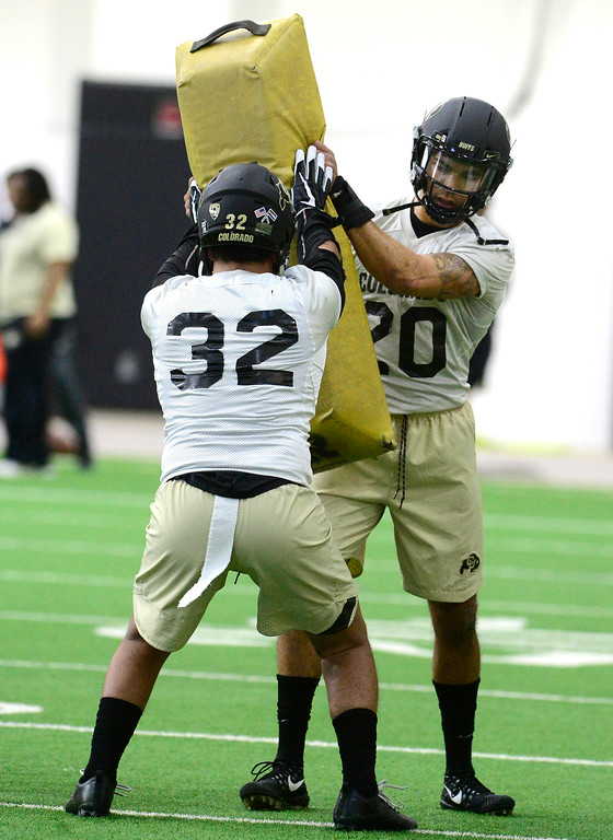 . University of Colorado\'s linebackers Rick Gamoa, 32 and, Drew Lewis, 20, in a drill  during practice on the CU Boulder Campus on Friday. For more photos go to buffzone.com Paul Aiken Staff Photographer Feb 23 2018
