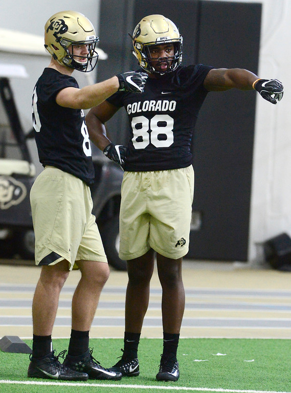 . University of Colorado\'s tight ends Derek Coleman, 80 and Darrion Jones, 88, discuss a drill during practice on the CU Boulder Campus on Friday. For more photos go to buffzone.com Paul Aiken Staff Photographer Feb 23 2018