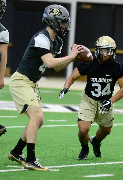 . University of Colorado\'s tailback Noa Lukela gets ready to take a handoff from quarterback Sam Noyer during practice on the CU Boulder Campus on Friday. For more photos go to buffzone.com Paul Aiken Staff Photographer Feb 23 2018