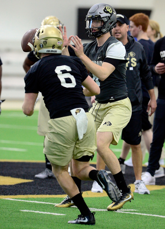 . University of Colorado\'s quarterback Sam Noyer readies to hand off to Curtis Chiaverini during practice on the CU Boulder Campus on Friday. For more photos go to buffzone.com Paul Aiken Staff Photographer Feb 23 2018