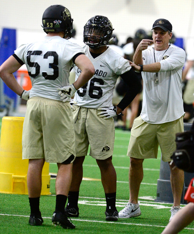 . University of Colorado\'s linebackers Nate Landman, 53, and Akil Jones, 36, take instruction from coach Ross Els during practice on the CU Boulder Campus on Friday. For more photos go to buffzone.com Paul Aiken Staff Photographer Feb 23 2018