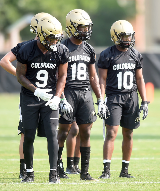 . Juwann Winfree, left, Tony Brown, and Jaylon Jackson, during CU Buffalo football practice on August 2, 2018. For more photos, go to buffzone.com. Cliff Grassmick  Staff Photographer  August 2, 2018