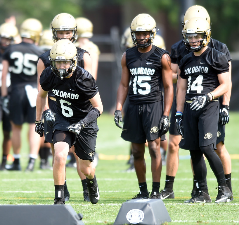 . Curtis Chiaverini, left, running drills during CU Buffalo football practice on August 2, 2018. For more photos, go to buffzone.com. Cliff Grassmick  Staff Photographer  August 2, 2018
