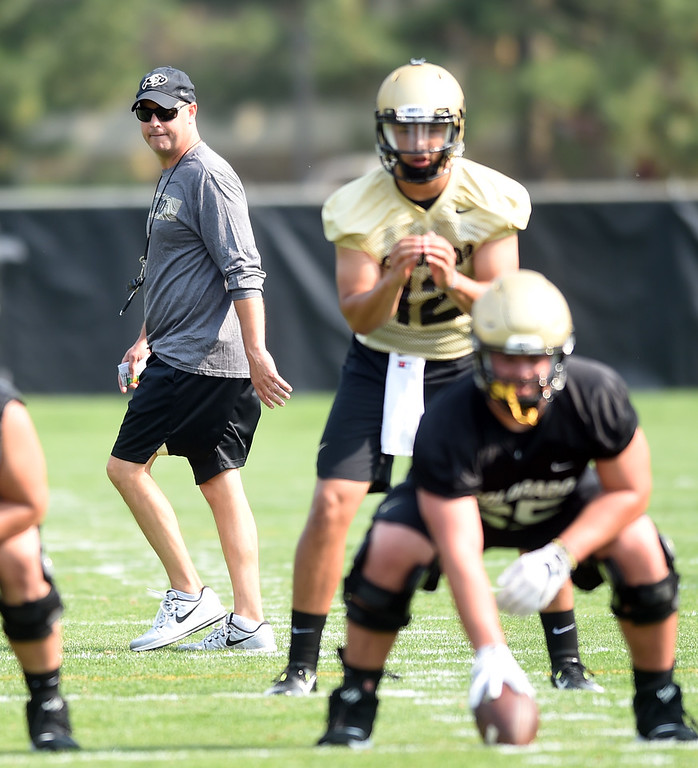 . QB coach, Kurt Roper, keeps an on on Steven Montez during CU Buffalo football practice on August 2, 2018. For more photos, go to buffzone.com. Cliff Grassmick  Staff Photographer  August 2, 2018