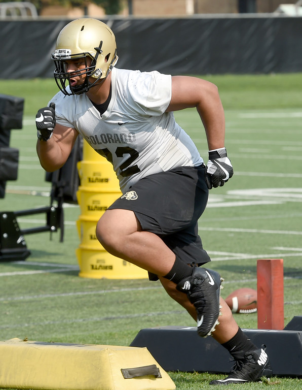 . Lyle Tuiloma doing defensive drills during CU Buffalo football practice on August 2, 2018. For more photos, go to buffzone.com. Cliff Grassmick  Staff Photographer  August 2, 2018