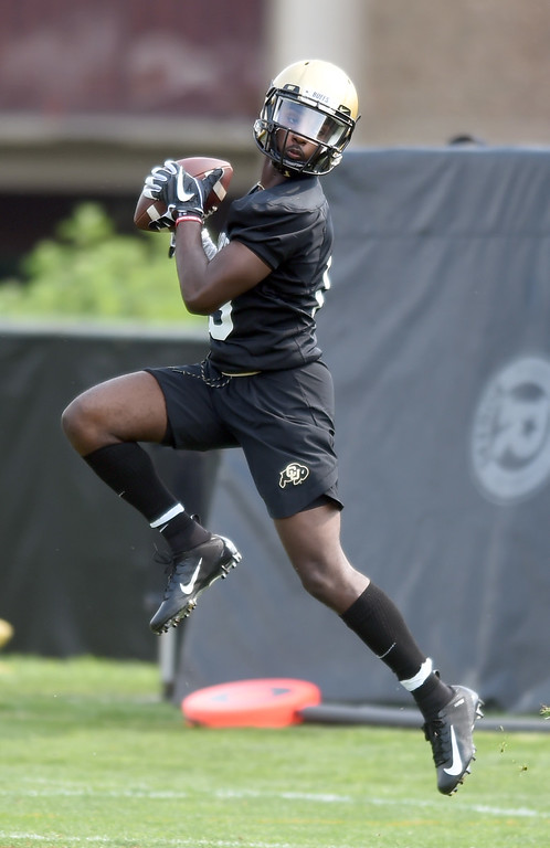 . Maurice Bell makes a catch during CU Buffalo football practice on August 2, 2018. For more photos, go to buffzone.com. Cliff Grassmick  Staff Photographer  August 2, 2018