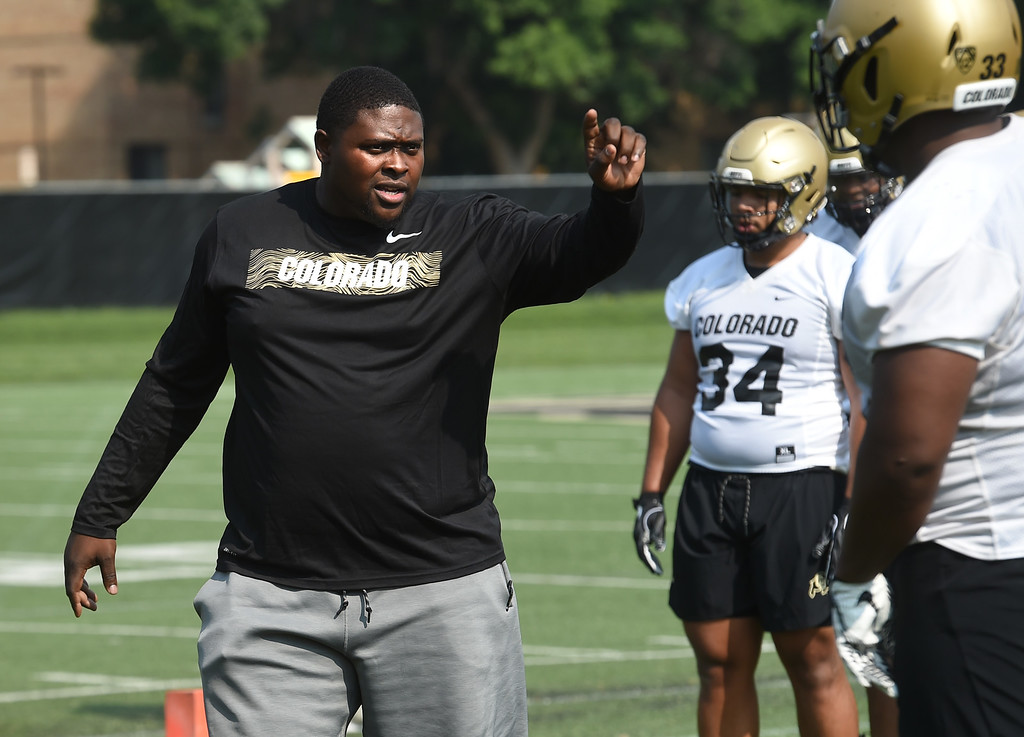 . Defensive line coach, Kwahn Drake, during CU Buffalo football practice on August 2, 2018. For more photos, go to buffzone.com. Cliff Grassmick  Staff Photographer  August 2, 2018