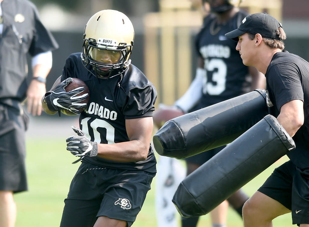 . Jaylon Jackson in a receiving drill during CU Buffalo football practice on August 2, 2018. For more photos, go to buffzone.com. Cliff Grassmick  Staff Photographer  August 2, 2018