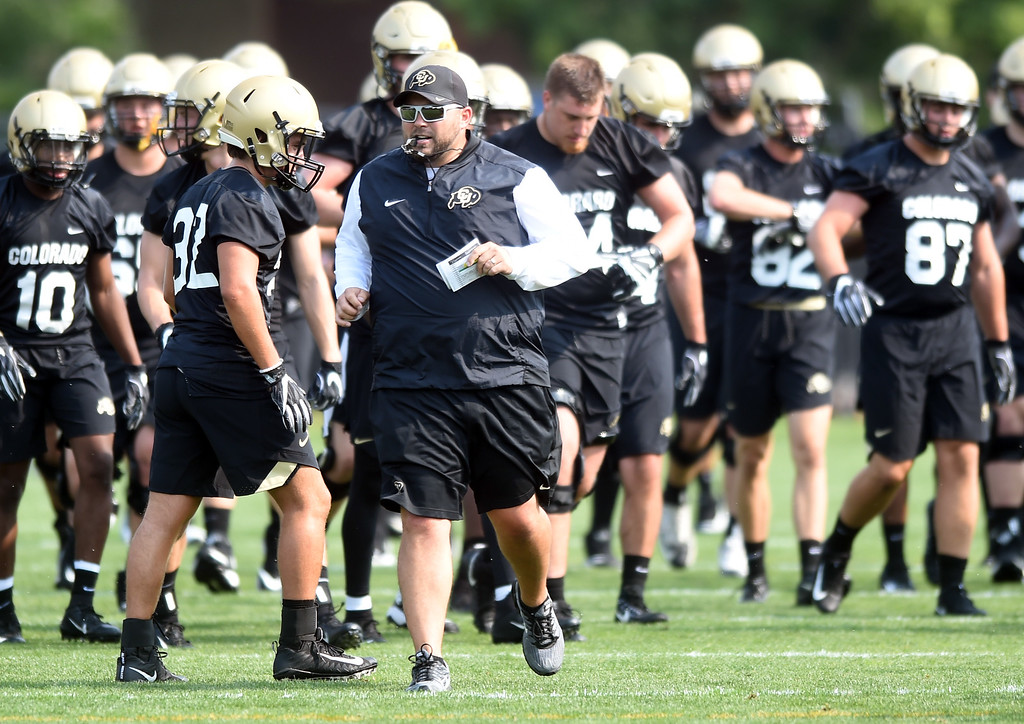 . O-line coach, Klayton Adams, during CU Buffalo football practice on August 2, 2018. For more photos, go to buffzone.com. Cliff Grassmick  Staff Photographer  August 2, 2018