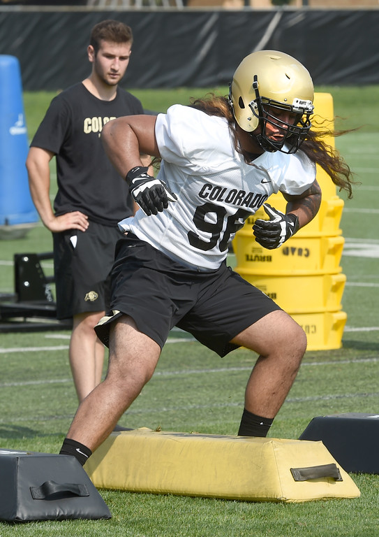 . Melekiola Finau doing defensive drills during CU Buffalo football practice on August 2, 2018. For more photos, go to buffzone.com. Cliff Grassmick  Staff Photographer  August 2, 2018