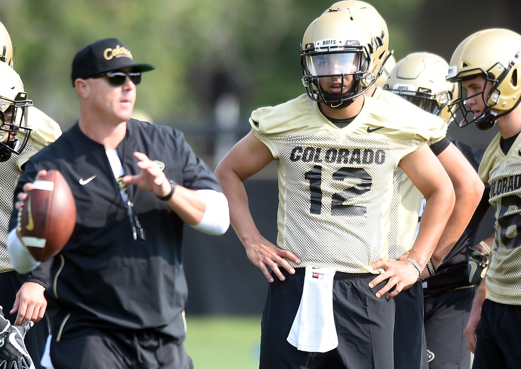 . CU QB, Steven Montez, watches Offensive Coordinator, Darrin Chiaverini, during CU Buffalo football practice on August 2, 2018. For more photos, go to buffzone.com. Cliff Grassmick  Staff Photographer  August 2, 2018