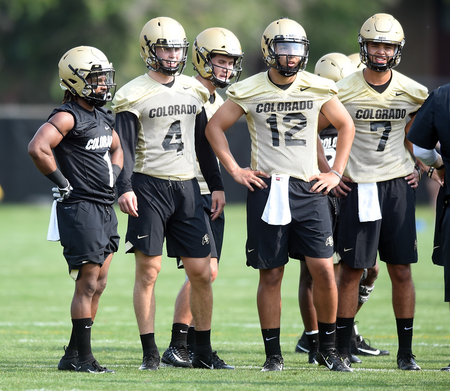 . Donovan Lee, left, Sam Noyer, Blake Stenstrom, Steven Montez, and Tyler Lytle, during CU Buffalo football practice on August 2, 2018. For more photos, go to buffzone.com. Cliff Grassmick  Staff Photographer  August 2, 2018