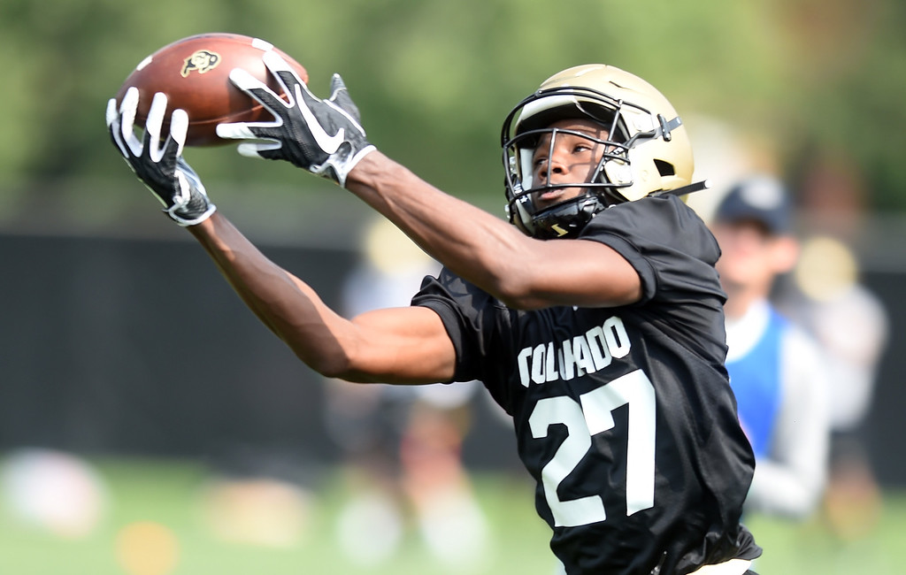 . Dylan Thomas catches a ball during CU Buffalo football practice on August 2, 2018. For more photos, go to buffzone.com. Cliff Grassmick  Staff Photographer  August 2, 2018