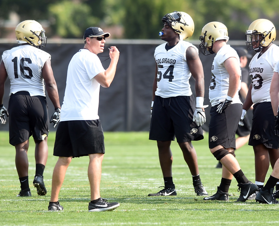 . Defensive Coordinator, D.J.Eliot, during CU Buffalo football practice on August 2, 2018. For more photos, go to buffzone.com. Cliff Grassmick  Staff Photographer  August 2, 2018