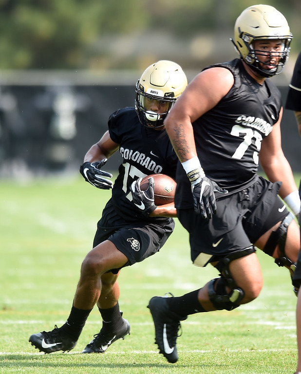 . Kabion Ento runs down field  during CU Buffalo football practice on August 2, 2018. For more photos, go to buffzone.com. Cliff Grassmick  Staff Photographer  August 2, 2018