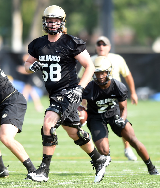 . Karry Kutsch running interference during CU Buffalo football practice on August 2, 2018. For more photos, go to buffzone.com. Cliff Grassmick  Staff Photographer  August 2, 2018