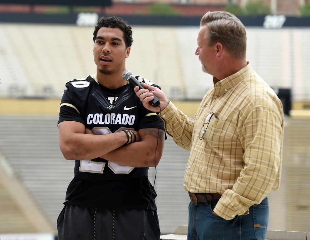 . Drew Lewis talks to Mark Johnson, of CUBuffs.com, during CU football and Fall sports media day. For more photos, go to dailycamera.com. Cliff Grassmick  Staff Photographer  August 4, 2018