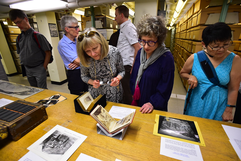 . Jane Tompson, left, and Susan Nevelow Mart look over a collection of photos of the West as part of a tour of the Special Collections Archives and Preservation in the Norlin Library on the University of Colorado Boulder Campus on Wednesday afternoon.  For more photos go to dailycamera.com Paul Aiken Staff Photographer June 6, 2018