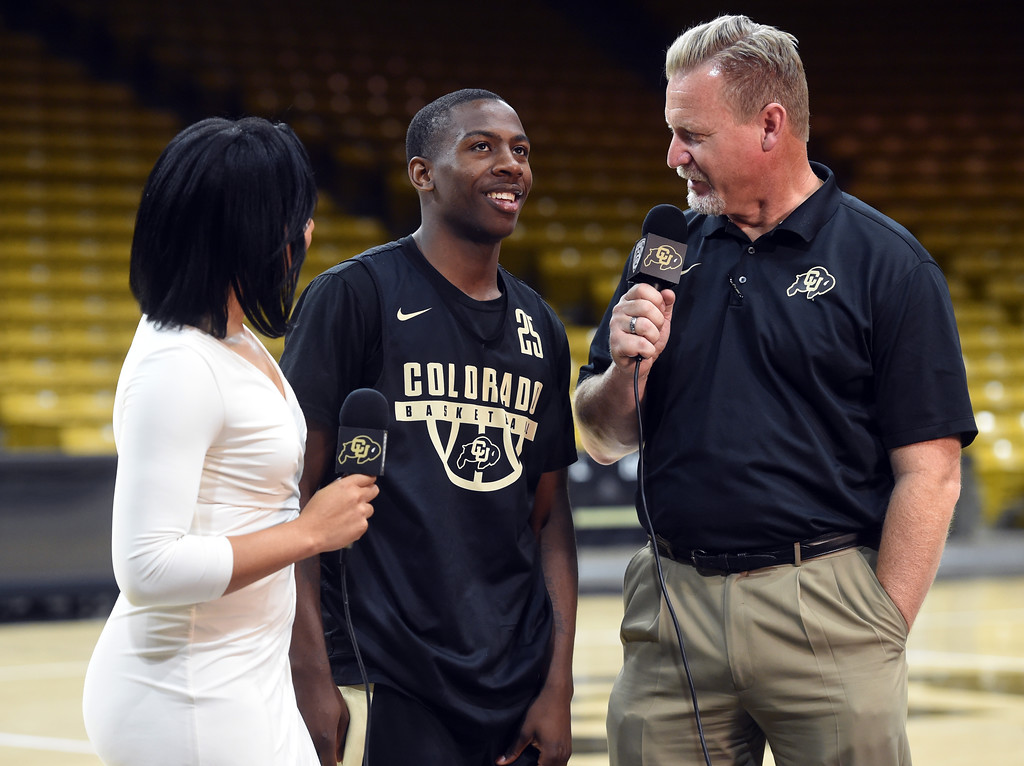 . McKinley Wright IV is interviewed by Ariana Freeman and Mark Johnson during media day. For more photos, go to buffzone.com. Cliff Grassmick  Staff Photographer October 18, 2017