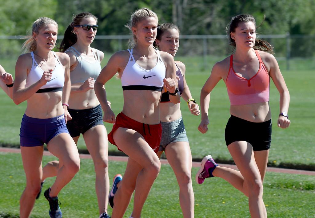 . Erin Clark, left, Shalaya Kipp, Val Constien, Makena Morley and Kaitlyn Benner workout during practice on June 1, 2018 at Potts Field. Cliff Grassmick  Staff Photographer  June 1, 2018