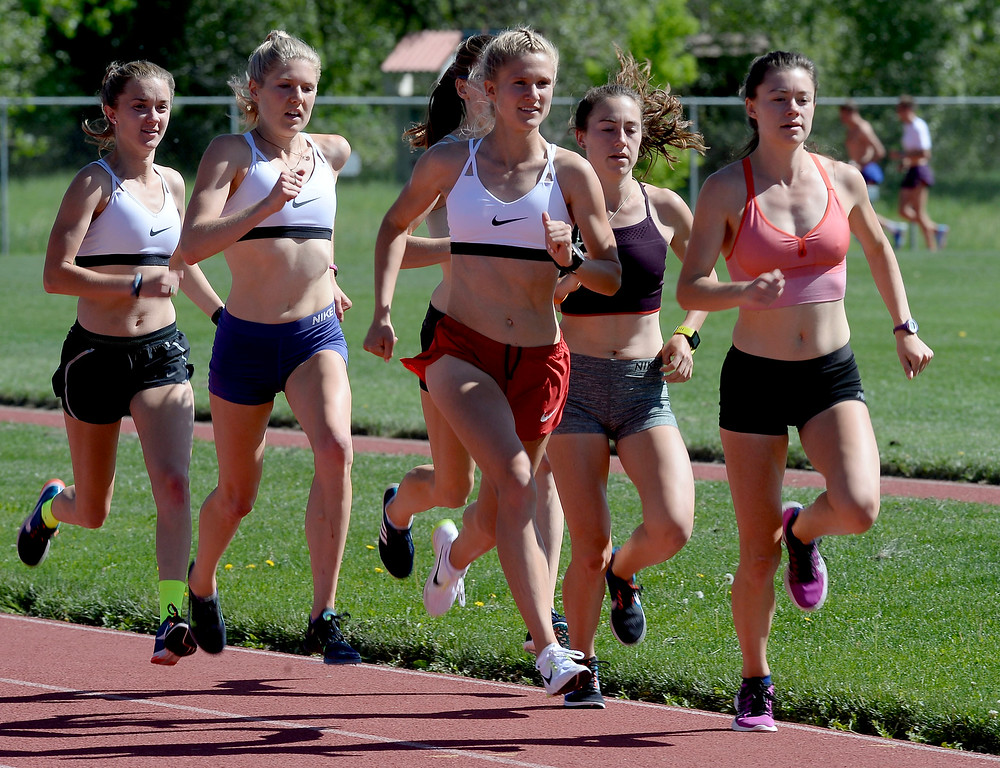 . Lucy May, left,  Erin Clark, Val Constien, Makena Morley and Kaitlyn Benner, run laps during practice on June 1, 2018 at Potts Field. Cliff Grassmick  Staff Photographer  June 1, 2018