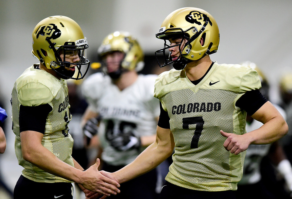 . BOULDER, CO - MARCH 22:University of Colorado\'s Tyler Lytle (No. 7) and Steven Montez (No. 12) during spring football practice at the Champions Center indoor practice fields in Boulder on March 22, 2019. (Photo by Matthew Jonas/Staff Photographer)
