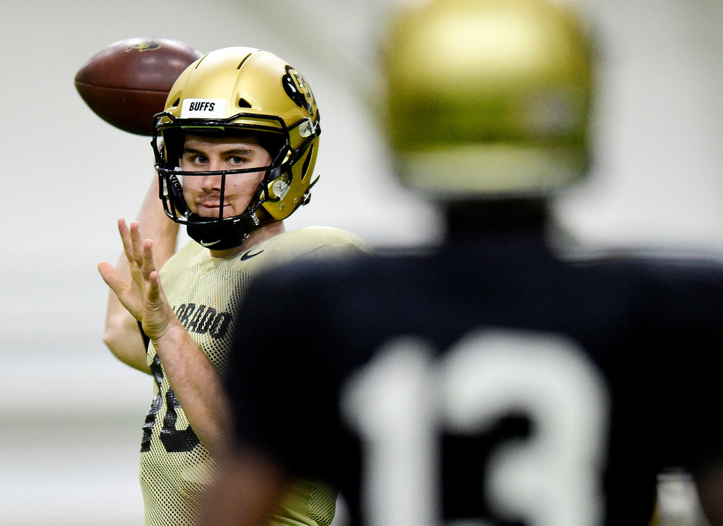 . BOULDER, CO - MARCH 22:University of Colorado\'s Blake Stenstrom (No. 16) throws to Maurice Bell (No. 13) during spring football practice at the Champions Center indoor practice fields in Boulder on March 22, 2019. (Photo by Matthew Jonas/Staff Photographer)