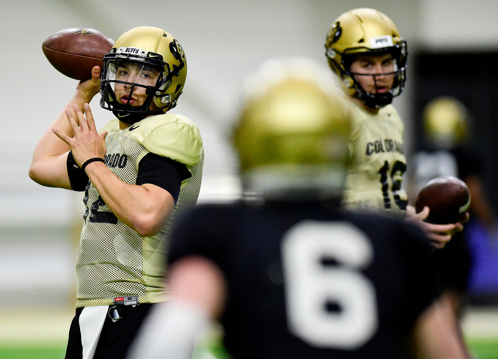 . BOULDER, CO - MARCH 22:University of Colorado\'s Steven Montez (No. 12) throws to Curtis Chiaverini (No. 6) during spring football practice at the Champions Center indoor practice fields in Boulder on March 22, 2019. (Photo by Matthew Jonas/Staff Photographer)