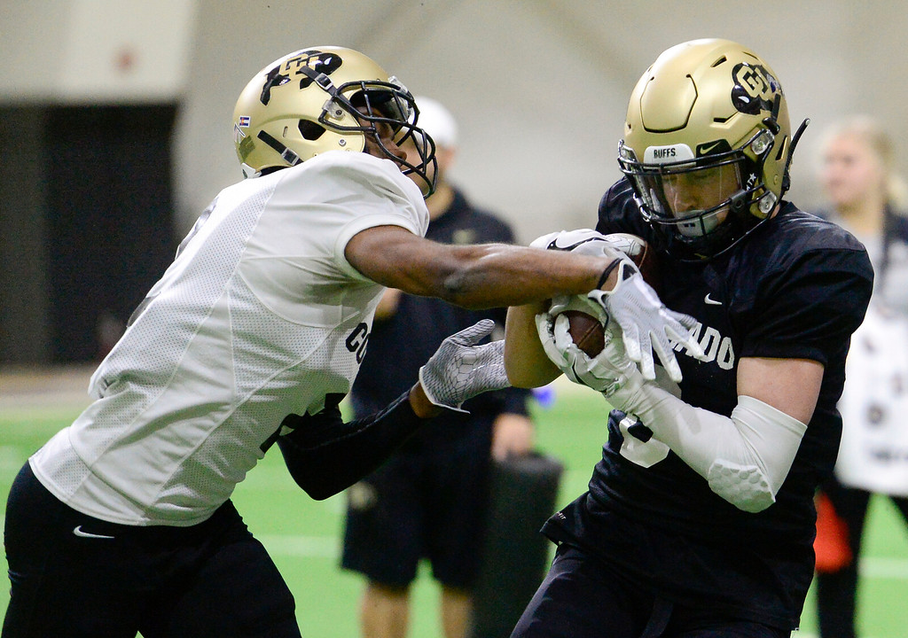 . BOULDER, CO - MARCH 22:University of Colorado\'s Ronnie Blackmon (No. 2) and Curtis Chiaverini (No. 6) during spring football practice at the Champions Center indoor practice fields in Boulder on March 22, 2019. (Photo by Matthew Jonas/Staff Photographer)