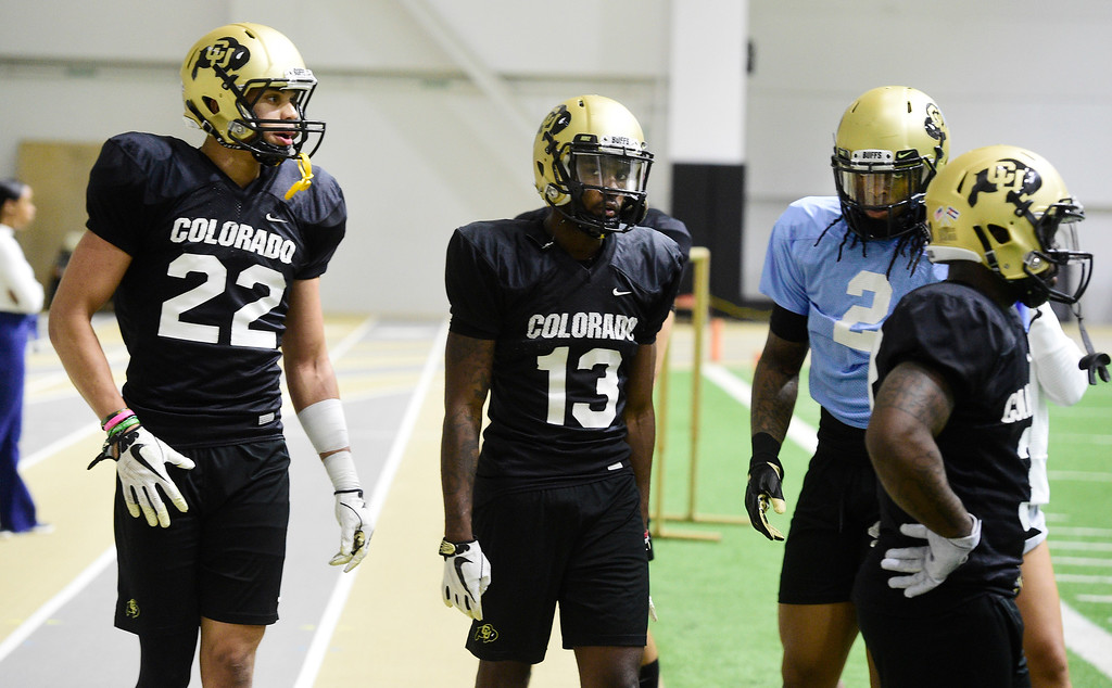 . BOULDER, CO - April 10, 2019: Daniel Arias, left, Maurice Bell, and Laviska Shenault, during Spring CU football practice. (Photo by Cliff Grassmick/Staff Photographer)