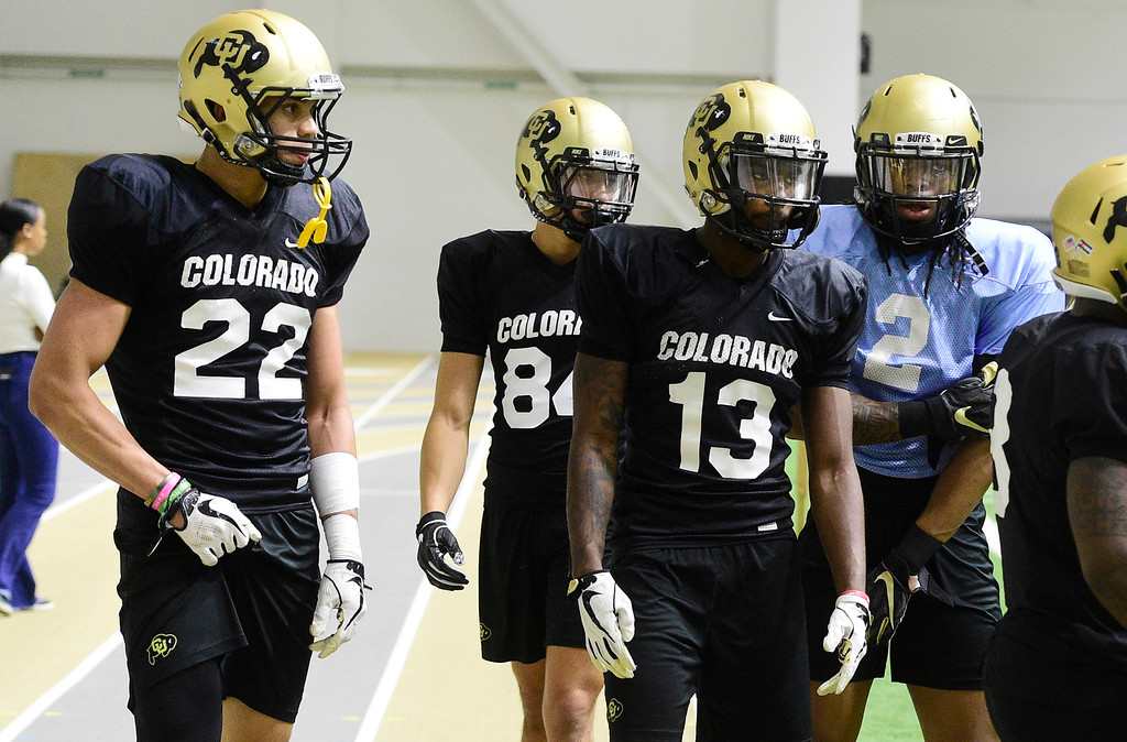 . BOULDER, CO - April 10, 2019: Daniel Arias, left, Clayton Baca, Maurice Bell, and Laviska Shenault,  during Spring CU football practice. (Photo by Cliff Grassmick/Staff Photographer)