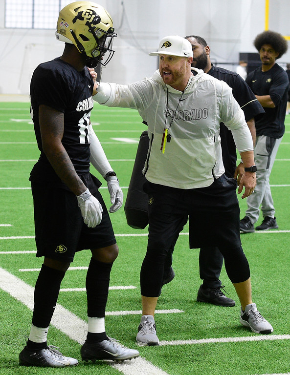 . BOULDER, CO - April 10, 2019: Receivers coach, Darrin Chiaverini, works with Tony Brown, during Spring CU football practice. (Photo by Cliff Grassmick/Staff Photographer)