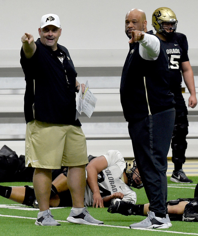 . BOULDER, CO - April 10, 2019:  Assistant coaches, Chris Kapilovic, left, and Jimmy Brumbaugh, during Spring CU football practice. (Photo by Cliff Grassmick/Staff Photographer)